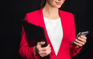 woman holding clipboard and phone