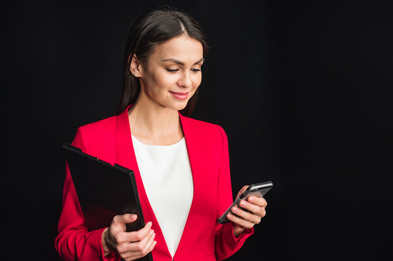 woman with phone and clipboard
