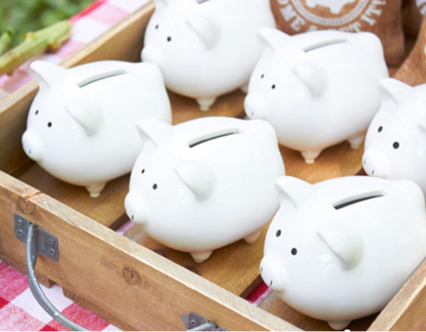 White Piggy Banks In A Crate As Birthday Party Favors