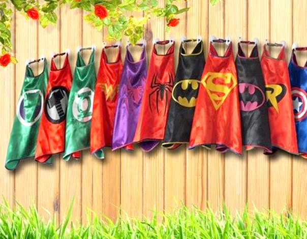 Assorted Superhero Capes Hanging On A Fence - Birthday Party Favors