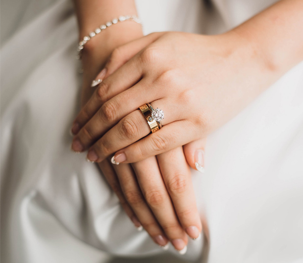 Accessorize Your Wedding Dress - Bride's Hands With Jewelry