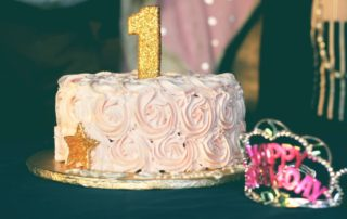1st Birthday Party - Frosted Cake With Gold Candle And Star