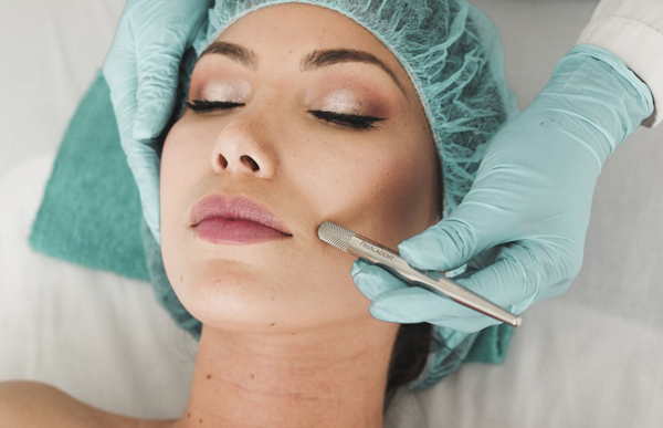 Brunette Woman Having Facial Performed