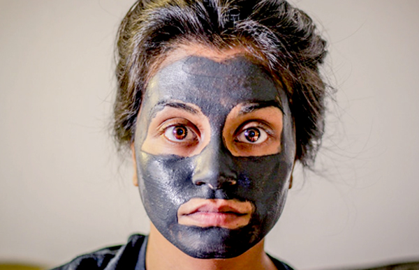 Bridal Skin Care - Brunette Woman With Dark Face Mask