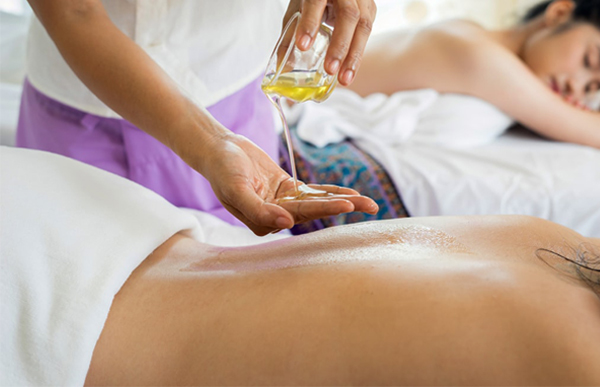 Two Women Getting Massage With Oil